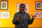 """Photo by Nathan Hoo: Greg """"Ritallin"""" Frankson announcing his new project, the Ottawa Poetry Slam Champion's Cup."""