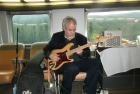 Ian Ferrier performing on the train
